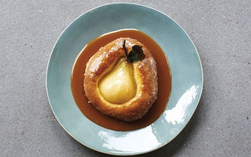 James Martin's whole poached pear baked in brioche with caramel sauce