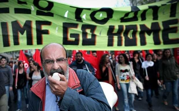 What happens if Greece defaults on its International Monetary Fund loans?