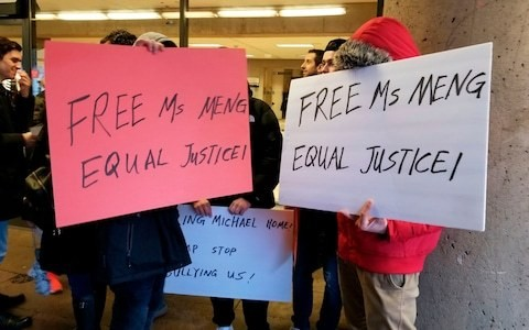 Huawei denies paying protestors outside finance chief's extradition trial