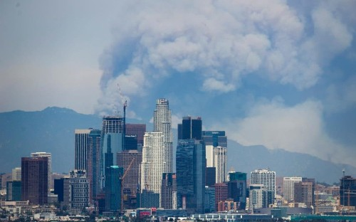 Smoke towers over Los Angeles skyline as fresh wildfires erupt in California
