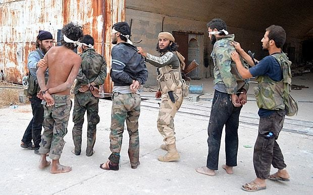 Militants execute 56 Syrian regime soldiers at captured airbase