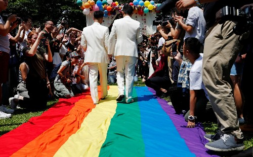 Taiwan celebrates first same-sex marriages in historic day for LGBTQ rights in Asia