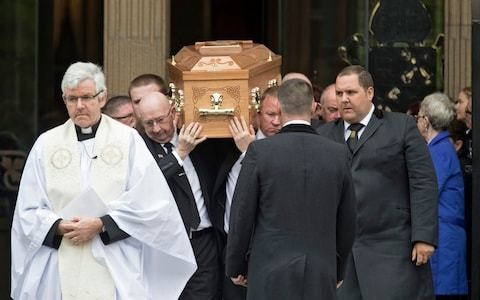 Lyra McKee funeral: standing ovation for priest who calls on politicians to work towards peace in her memory