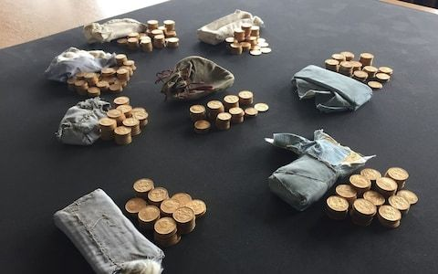 Proceeds from Britain's largest ever hoard of gold coins to be shared with piano tuner who found them