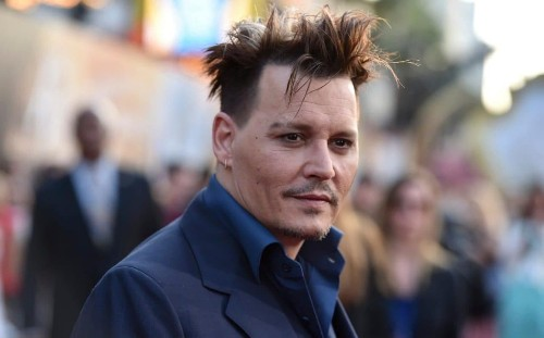 Johnny Depp was 'fed lines through an ear piece so he didn't have to learn them', former managers claim