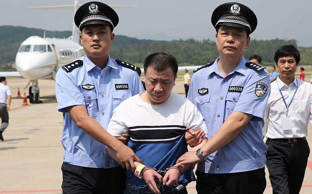 Corruption suspect returned to China from US ahead of Xi Jinping visit