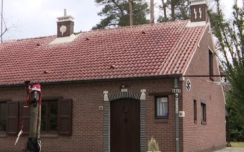 Owner of Belgium's 'Nazi house' faces year in jail