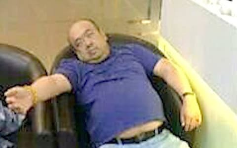 Picture emerges of Kim Jong-nam slumped over moments before his death as second post mortem to be conducted