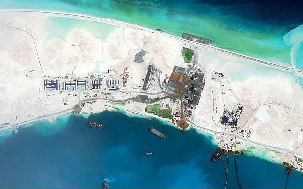 China 'building third airstrip on disputed South China Sea islands'