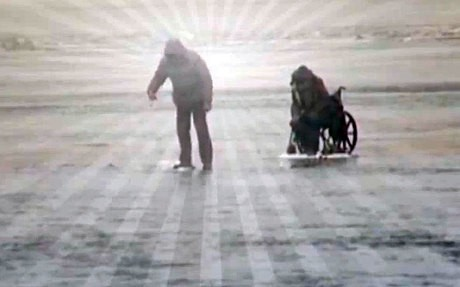 Rescuers save wheelchair fisherman on thin ice