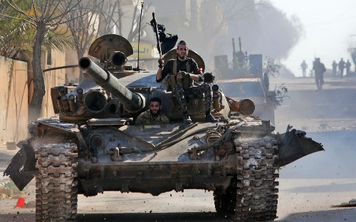 Syrian rebel forces recapture key town in blow to Assad