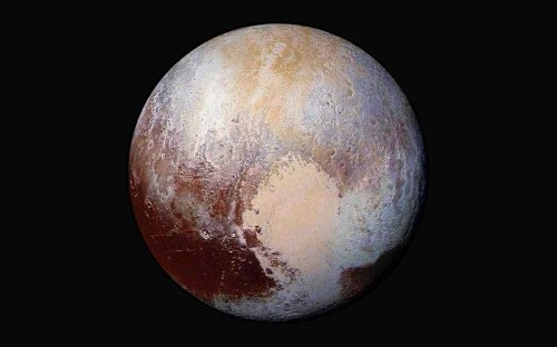 Pluto's frozen heart may hide underground ocean that flipped planet over