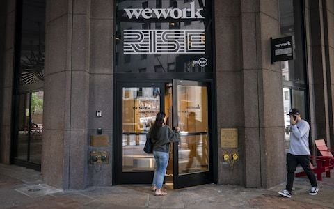 Softbank seeks control of WeWork with new investment as co-working company faces cash crunch