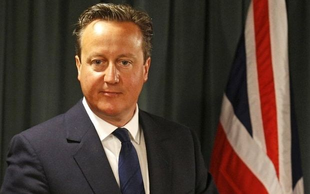David Cameron confirms Britain will act with its 'head and its heart' and accept thousands of refugees