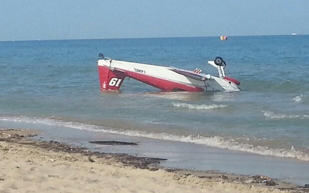 Pilot dies after light planes collide during air show