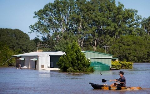 Australia floods leave tens of thousands stranded and four missing