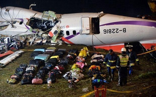 TransAsia plane crash: pilot's body found still clutching joystick