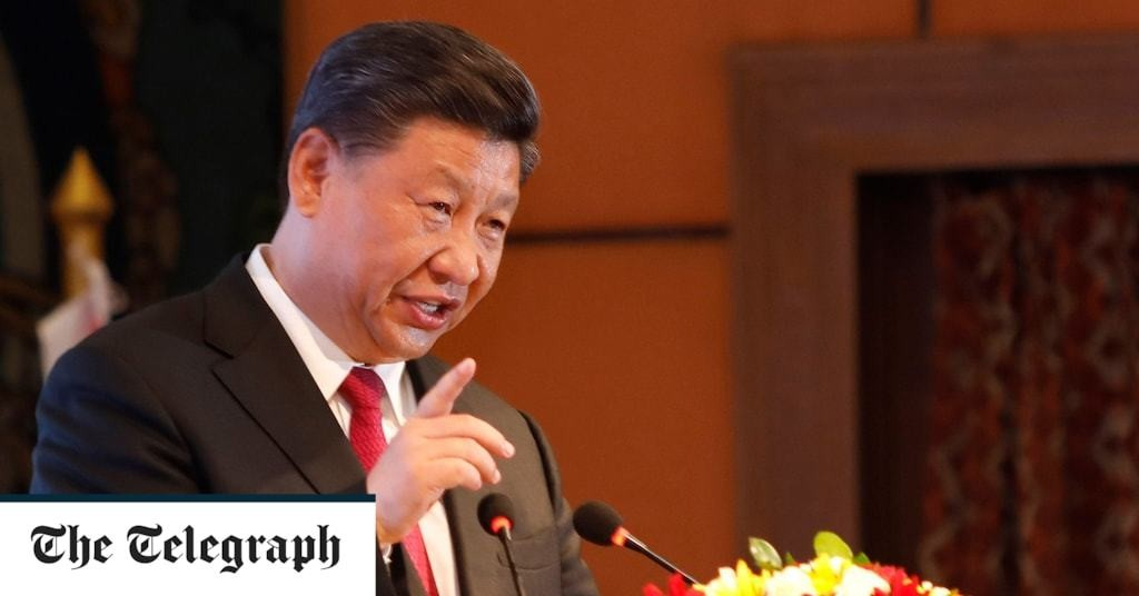 China's Xi warns efforts to divide China will end with 'crushed bodies and shattered bones'