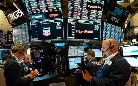 Tiny band of just 77 stocks drives markets to record highs