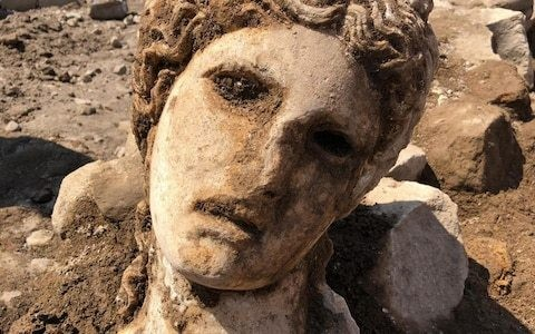 2,000-year-old marble head of god Dionysus discovered under Rome