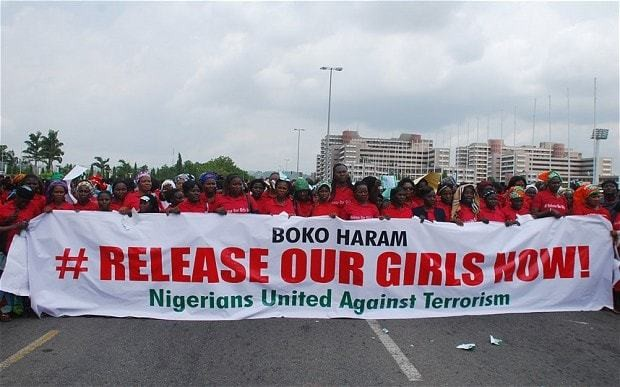 Nigeria schoolgirls: police say first arrest made over kidnapped students