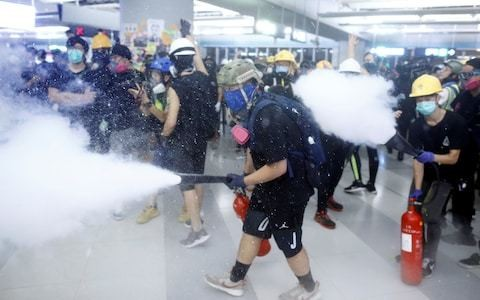 Supporters of British Consulate official detained by China stage protests in Hong Kong