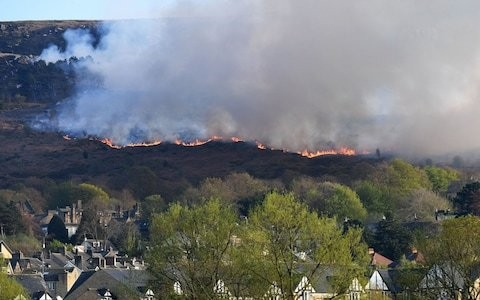 Wildfires spread across moorland on hottest day of the year