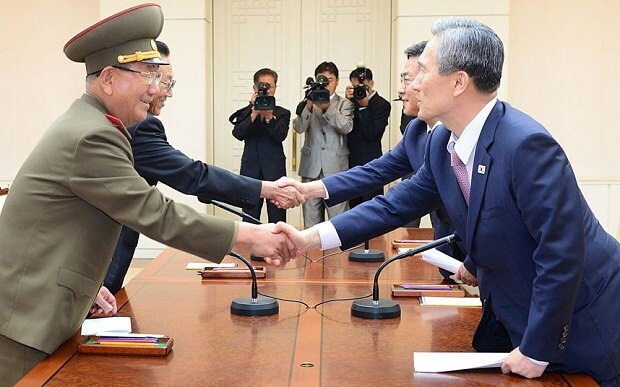 North and South Korea back from brink of war as propaganda broadcasts halted