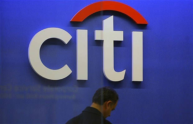 Citigroup and Bank of America profits hit as mortgage clean-up continues