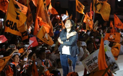 Peru election: voters choose between imprisoned strongman's daughter and banker related to Hollywood royalty
