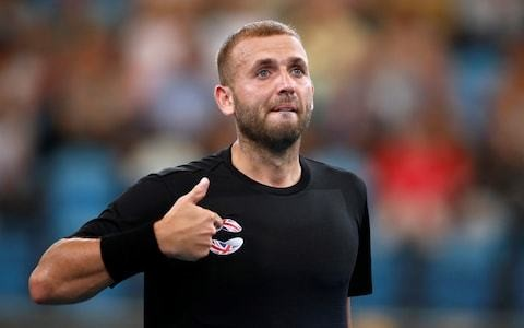 Dan Evans fights back from two sets down to beat Mackenzie McDonald at Australian Open