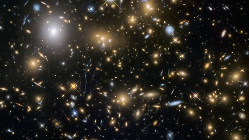 The Eerie Alignment of Ancient Giant Galaxies