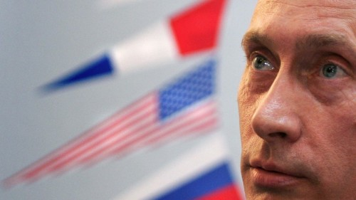 Putin Pays Backhanded Tribute to Democracy