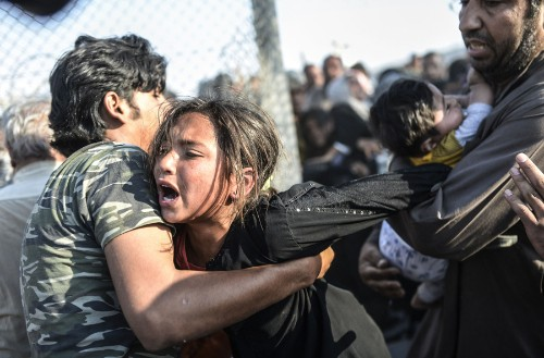 Syrians Crash Through a Fence Between War and Refuge