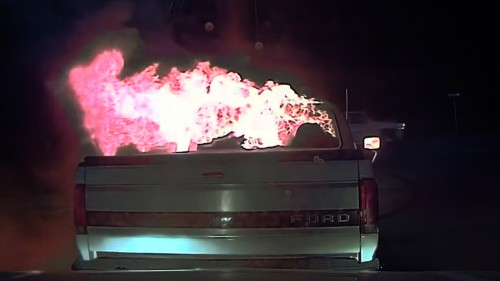 Watch: Police officer saves building by pushing burning truck away with his own patrol car