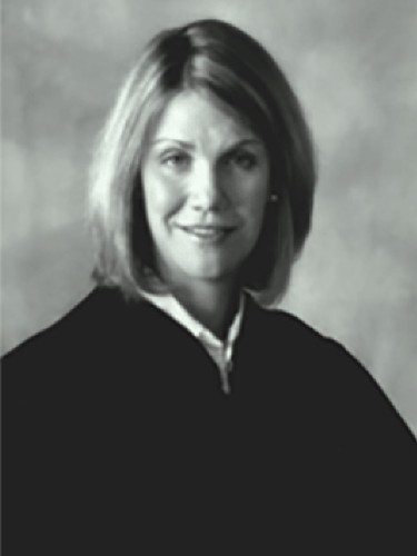 Police: Texas District Judge Shot Outside Her Home