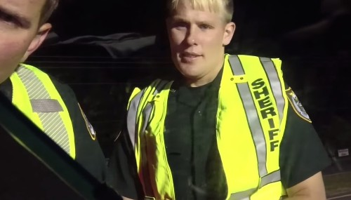 See This Guy Get Through a DUI Checkpoint Without Saying a Word — Thanks to What He Hung Out His Car Window