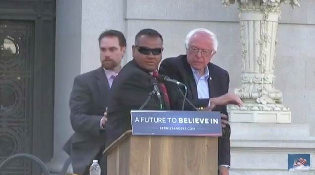 Animal Rights Activists Jump Barricades and Try to Rush Podium at Sanders Rally in Oakland