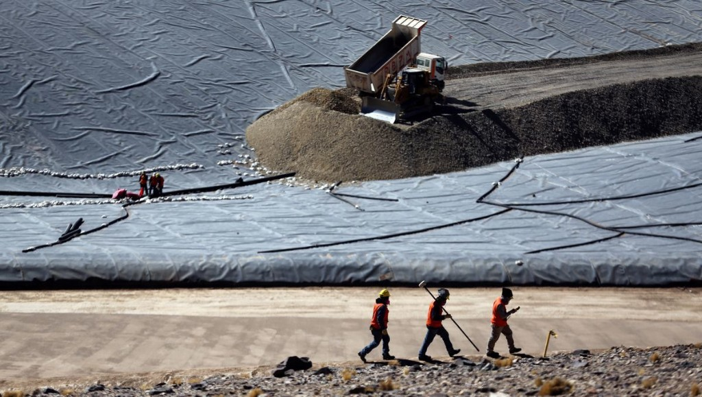 Barrick profit tops forecasts as gold prices surge; hikes dividend