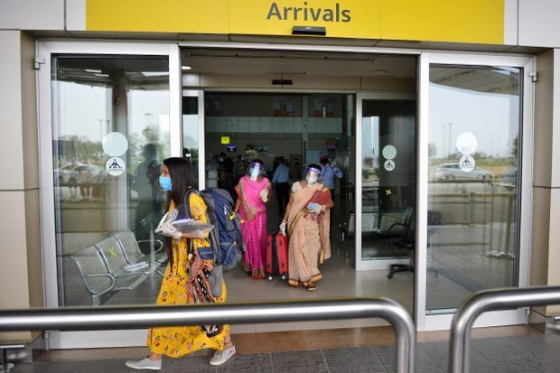 India reports its biggest single-day jump in COVID-19 cases as domestic air travel allowed to restart