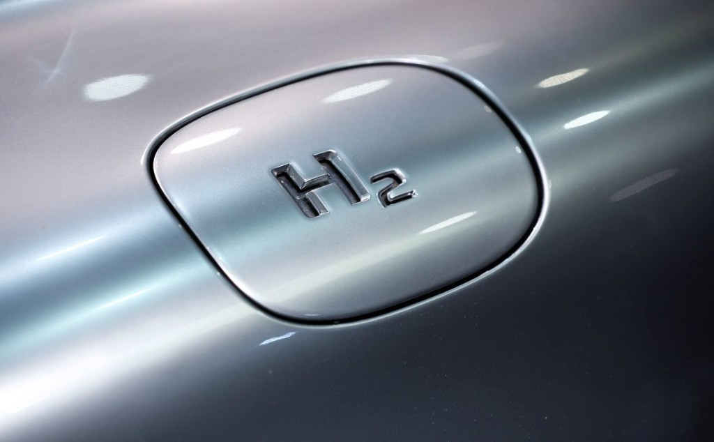 What are the advantages and disadvantages of hydrogen fuel cells versus battery-electric cars?
