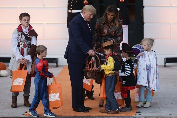 Donald and Melania Trump Putting Candy Bar on Head of White House Trick-or-Treater Dressed As Minion Has Become a Flash Point