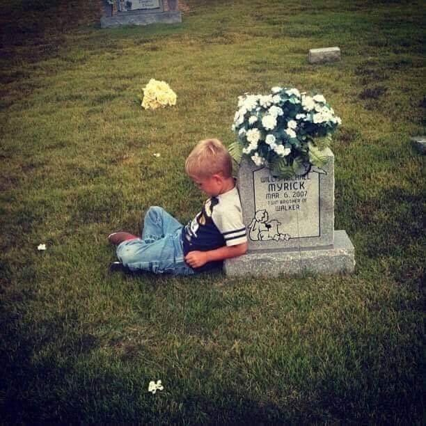 How a Heartbreaking Photo of a Boy at His Twin's Gravesite Healed Their Family
