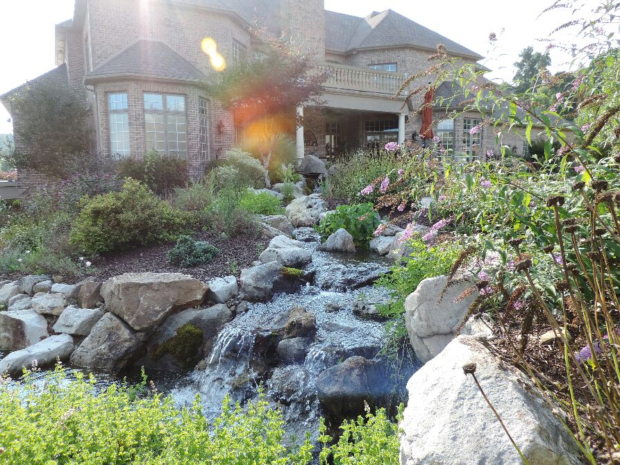 Beautiful Pond With Large Stream And Waterfall - cover
