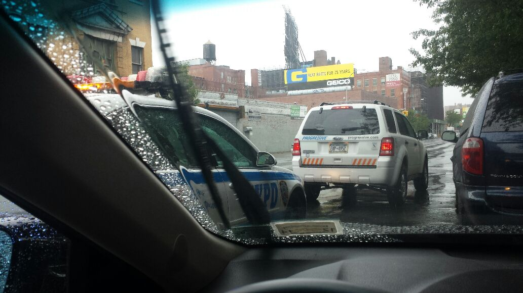NYPD OFFICER PULLING OVER PROGRESSIVE DRIVER. - Magazine cover