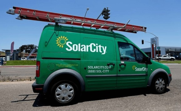 Tesla presses case for SolarCity merger saying it would add $1 billion to 2017 revenue