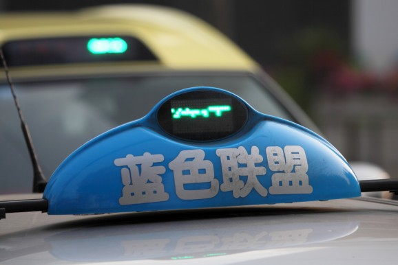 Money-burning taxi apps go to war in China