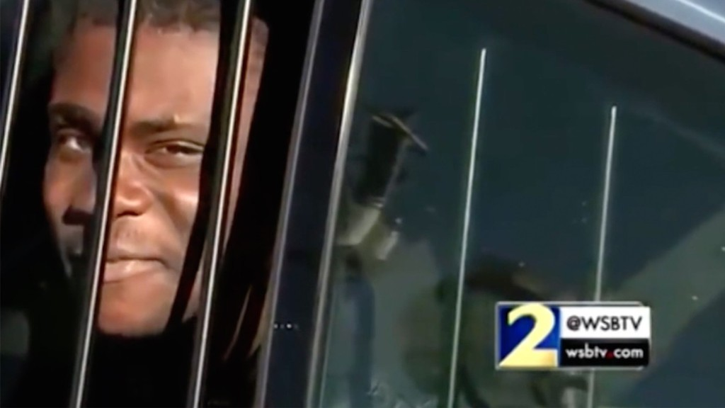 This Alleged Burglar Roasted a Reporter from the Back of a Cop Car