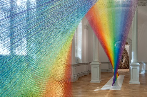 Miles of Thread and a Giant Needle Weave Indoor Rainbows