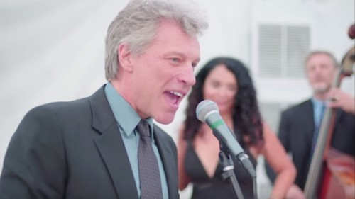 """Watch Poor Bon Jovi Get Roped into Singing """"Livin' on a Prayer"""" at a Wedding Party"""